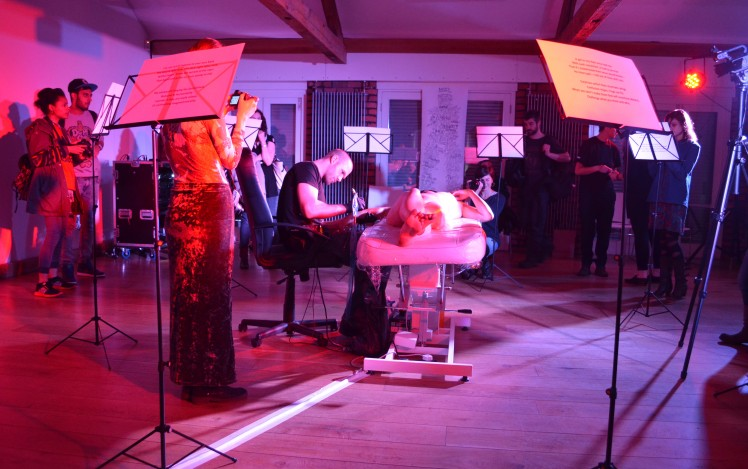 Bathed in Red Light, Surrounded by Music Stands